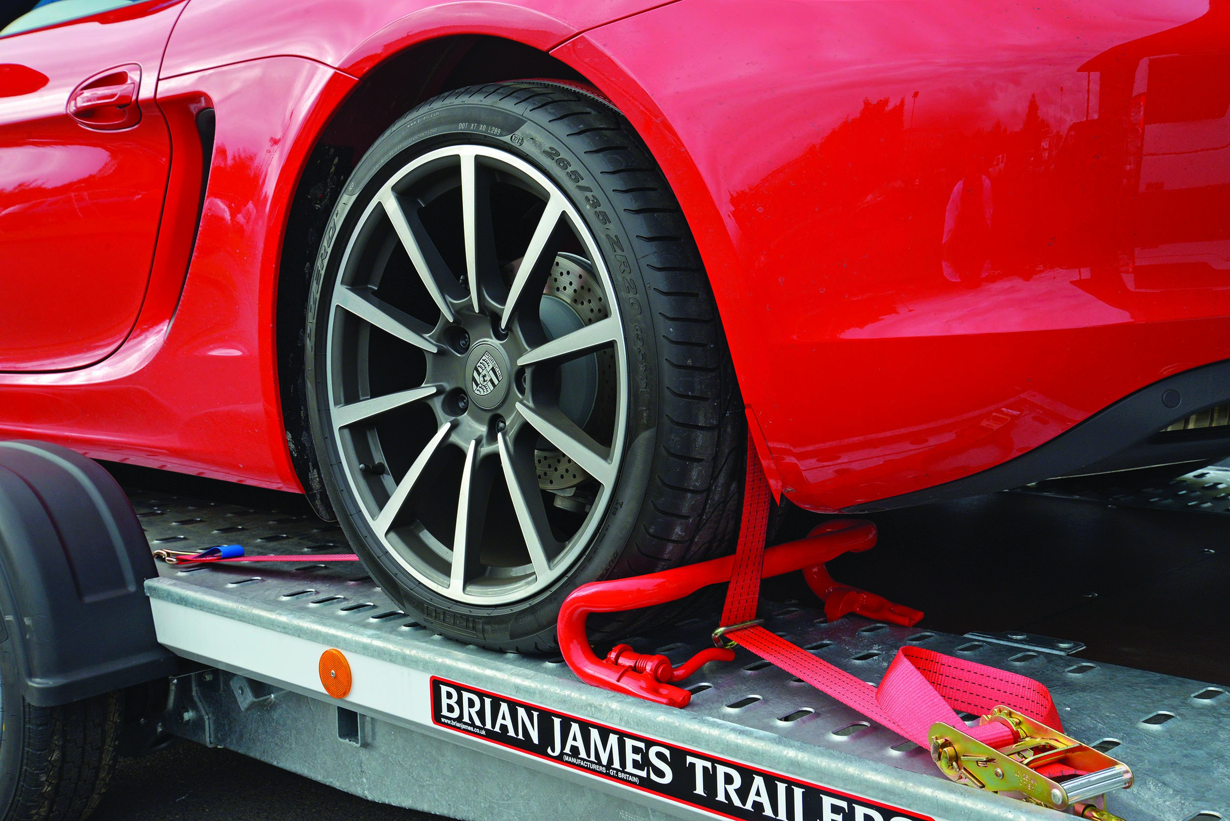 Fixed sports car to a Brian James Trailer